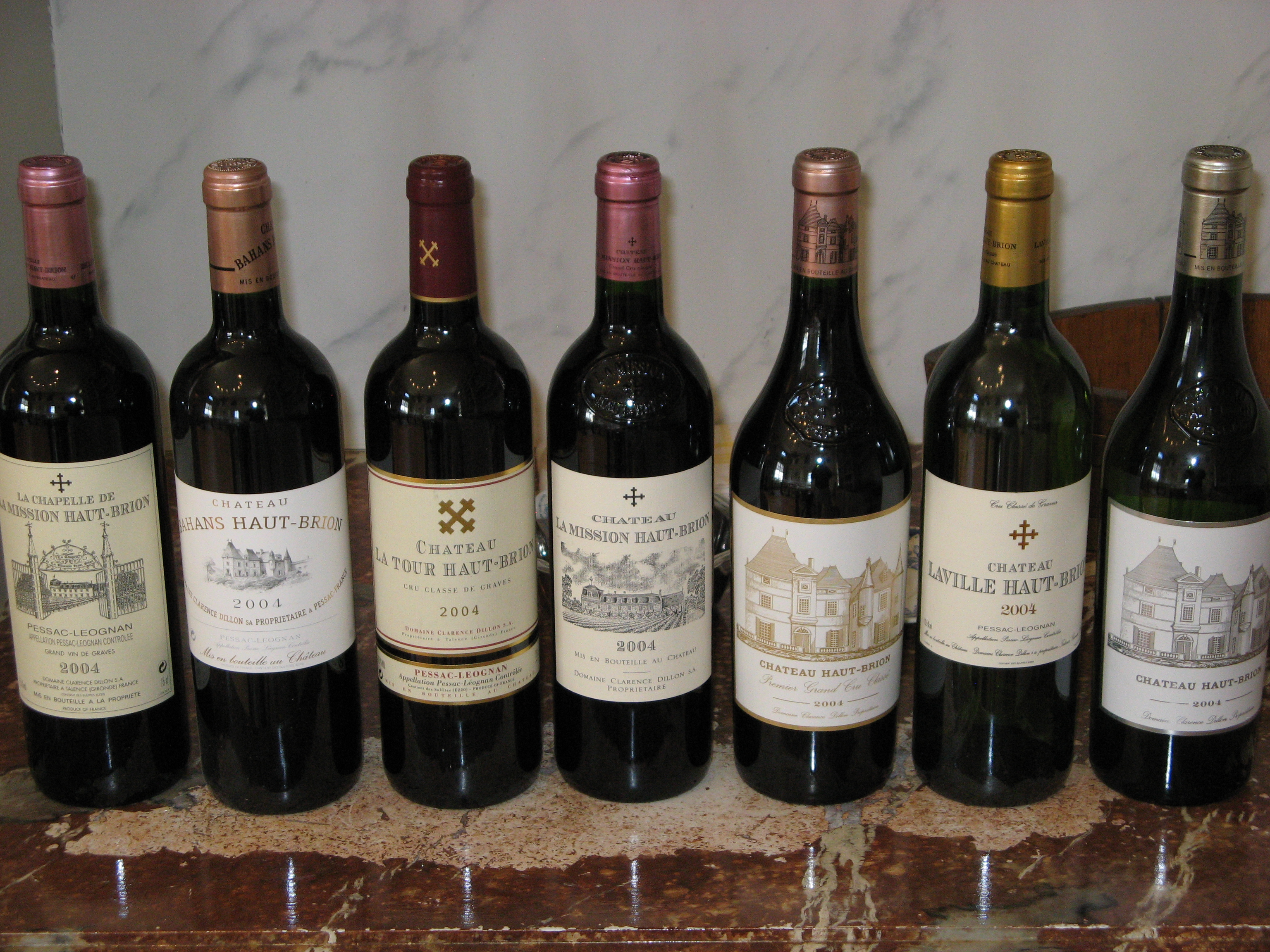 A wine appraisal performed on various bottles of vintage Chateau Haut Brion.